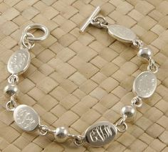Monogrammed Mother's Oval Bead Sterling Bracelet with Names. I am in love with this!! Definitely asking for this for my birthday or Christmas with all of our initials. So sweet!