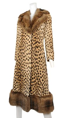 Vintage Donald Brooks Leopard & Sable Coat. I am an animal lover so I would never wear this coat BUT I appreciate the look and style of it, and the visual appeal of the image....