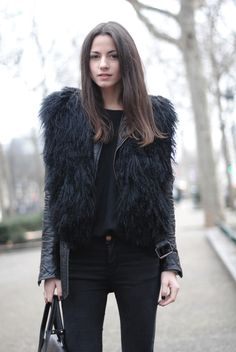fur vest on leather jacket