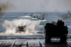 Amphibious assault vehicles launch from the well deck of the  USS Ashland (LSD 48). #rebalance @USNavy