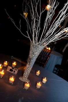 Quite simply but in a warmer colour would look effective, easy to intertwine fairy lights