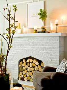 good way to display unusable fireplace... Danielle-Moss - eclectic - living room - chicago - Cynthia Lynn Photography