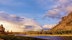 madison river and sky with 1988 forest f Photo by Jason Wiles — National Geographic Your Shot