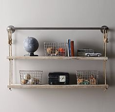 Industrial Pipe & Rope Shelf  I love this shelf but think it is probably too big.  They do a smaller option which we could maybe consider.