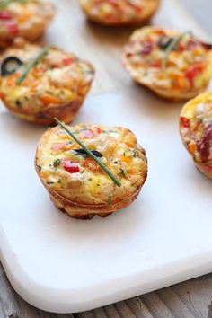 Light and fluffy egg frittata muffins with Italian sweet red peppers and goat cheese nestled into a tortilla base. Bake in a cast iron skillet or bake them in a muffin pan for an easy quick breakfast!