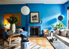 Gravity Home: Blue living room in A Designer's Eclectic Brooklyn Brownstone Paint My Room, Most Popular Paint Colors, Gravity Home, Comfy Sofa, Kabine, Home Trends, Furniture Arrangement, Living Spaces, Living Rooms
