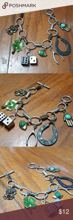 "Vintage charm bracelet Ive had this in my jewerly box for over 30 years!  I bought it at an estate sale in Texas.   Measures 8"".  Lots of fun charms on this silver bracelet. A lucky cat, a 4 leaf clover, a set of dice, a wishbone, a horseshoe, a hand & an eye.  Love! Jewelry Bracelets"
