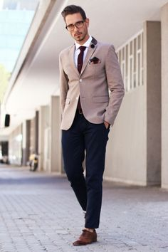 Stand out among other stylish civilians in a brown blazer and navy chinos. Rock a pair of dark brown leather oxford shoes for a masculine aesthetic.  Shop this look for $190:  http://lookastic.com/men/looks/dress-shirt-chinos-oxford-shoes-belt-blazer-pocket-square-tie/4128  — White Dress Shirt  — Navy Chinos  — Dark Brown Leather Oxford Shoes  — Dark Brown Leather Belt  — Brown Blazer  — Burgundy Print Pocket Square  — Burgundy Wool Tie