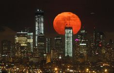 The moon rises over the skyline of Manhattan and One World Trade Center (left) in New York on May 6, 2012. (Gary Hershorn/Reuters)
