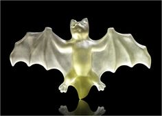 A hardstone model of a bat Fabergé, circa 1900 of carved agate set with demantoid garnet eyes, depicted with wings splayed