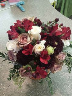 Burgundy, taupe and white bouquet featuring burgundy dahlias, Amnesia roses, white roses, burgundy alstromeria and hypericum berries #gouldsflowers #716433ROSE #gouldsflowers&gifts www.gouldsflowers.com