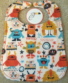 Orange Monsters Baby Bib by CraftyToucan
