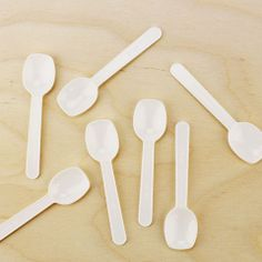 Mini White Plastic Taster Spoons from www.layercakeshop.com  Qty.48/$2.00