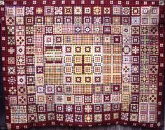 Soldier's Coverlet 1860 - 1889 from the UK Quilt Museum and Gallery. Military uniform wool squares