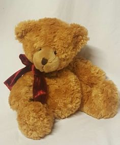 "Russ teddy bear "" Honey "" The 8"" honey colored plush stuffed animal with a red bow around its neck. Gently pre owned condition free of odors, rips , tears etc. Thank you!"