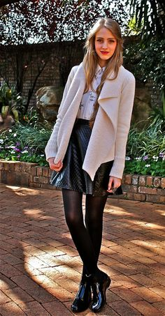 White blouse on a leather skirt