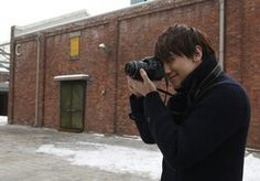 He is taking pictures.
