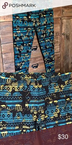 LuLaRoe TC Leggings Turquoise/teal with black & yellow graphic. NWT These are a smidge more teal than the picture shows LuLaRoe Pants Leggings