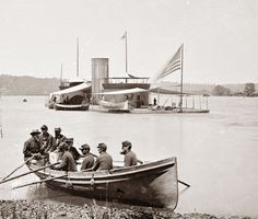 James River, Virginia in 1864. It shows the Union ironclad ship, the Onondaga. A group of sailors are on their way out to board the ship. Looking at these old ironclads, and imagining them in the summer in the south, I would have to think that they were unbearably hot inside.