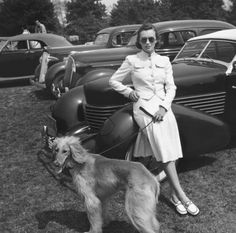 Photographer Toni Frisell posing with a Afghan Hound, Vogue US, 1939.