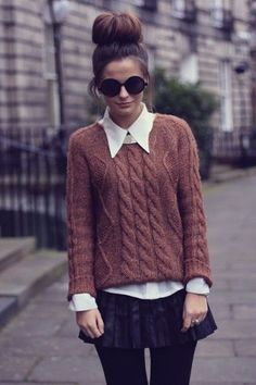 cable knit sweater with collared shirt and mini skirt, black tights, high bun