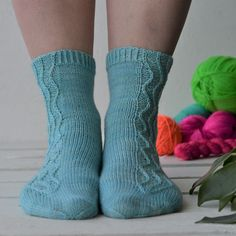 Free knitting pattern for a pair of socks with a simple slipped stitch cable that ebbs and flows and takes inspiration from the Mediterranean. Stitch Patterns, Knitting Patterns, Work Flats, Cable Needle, Wave Pattern, Stockinette, Garter Stitch, Needles Sizes, Toe Shape