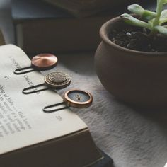 Add a little character to your books and journals with these vintage button bookmarks - a simple DIY that only takes a few minutes!