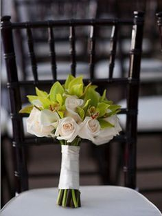 Roses say classic. Cymbidium orchids say exotic. While you wouldn't think to mix them in one bouquet, it totally works. We think it's especially perfect for a formal beach wedding.    Read more: 41 Unexpected Flower Ideas - TheKnot.com http://wedding.theknot.com/wedding-planning/wedding-flowers/articles/41-unique-wedding-flower-ideas.aspx?page=13#ixzz1XSmspRP3