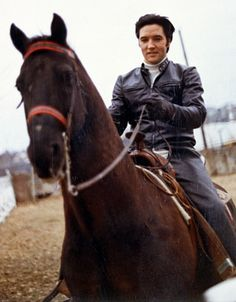Elvis riding at his family home, 1968