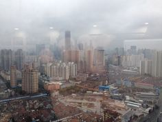 Ghostly reflections on a Shanghai urbanscape from Time Publishing's offices