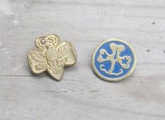 These were the Girl Scouts pins of my childhood (1960s) - left, the Girl Scouts pin, right, the World Association pin.
