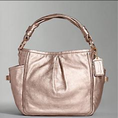 Coach nickel leather Gently used.  See pics Coach Bags