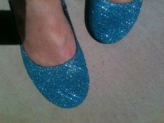 DIY Glitter Shoes.  Hummm.. I have old shoes.  I like shiny glittery things.  My daughters like shiny glittery things.  Ok, I'm game.