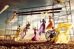 This is a really good idea for a prom pic; to have people standing at various angles on a swingset