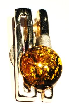 Contemporary Style Amber Pendant $60 http://www.thesilver-lady.com/components/com_virtuemart/shop_image/product_0811/Contemporary_sty_4e010c669b20c.jpg