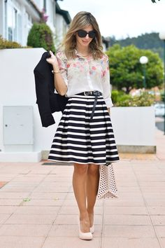 Mixed prints. White sheer blouse with floral detail at shoulders, black and white striped skirt, blush heels, and blush tote with polka dot cutouts