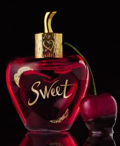 "New Lolita Lempicka perfume ""Sweet"". Top notes: cherry lip gloss, sugar; Heart: angelica, cocoa, iris; Base: musk, cashmere"