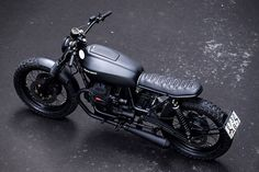 the custom motorcycle started its life as a 1999 moto guzzi nevada 750 that recast moto modified into this classic scrambler coated in charcoal paint.