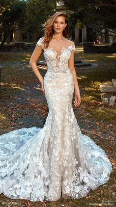 Deep V-neck Cap Sleeve Beaded Lace Applique Fit And Flare Wedding Dress by Eve of Milady - Image 1 zoomed in Wedding Dress Styles, Dream Wedding Dresses, Wedding Attire, Bridal Dresses, Wedding Gowns, Wedding Dressses, Fairy Wedding Dress, Fit And Flare Wedding Dress, Eve Of Milady