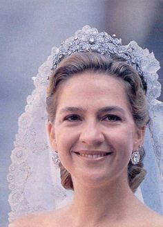 At her wedding Dona Chrisitna wore the floral tiara and Queen Victoria Eugenia''s diamond earrings: