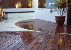 Curved Ipe Deck With Natural Stone. Like the idea of curved line and mixing mediums for the deck. breaking up the monotony. Mall Design, Patio Design, Garden Design, Small Gardens, Outdoor Gardens, Hardwood Decking, Curved Decking, Sandstone Paving, Chelsea