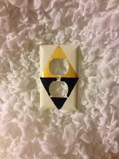 The Legend of Zelda: A Link Between Worlds TriForce Outlet Cover  on Etsy, $2.00