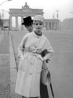 Ina Balke in coat by Gehringer & Glupp in front of Brandenburg Gate, Berlin, photographed for Beyer Moden, Spring/Summer 1960