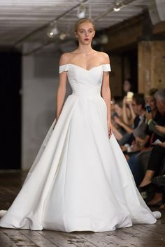 Simple wedding dress with off-the-shoulder sleeves and ball gown silhouette. | Rivini's Fall 2017 Collection at New York Bridal Fashion Week
