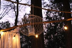 A whimsical tea party in the woods was created using repurposed materials — many from the Habitat ReStore. Habitat Restore, Habitat For Humanity Restore, Habitats, Restoration, Home Improvement, The Secret, Chandelier, Diy Crafts, Ceiling Lights
