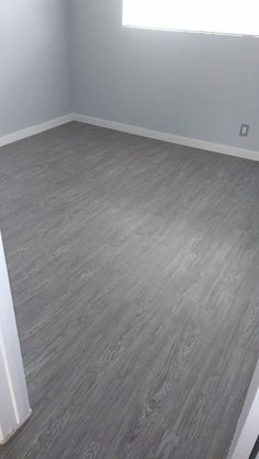 vinyl flooring Another finished Plank Vinyl installation. What do you think Schedule yours today! Grey Wood Tile, Grey Wood Floors, Wood Tile Floors, Grey Walls, Living Room Flooring, Bedroom Flooring, Grey Vinyl Plank Flooring, Grey Laminate Flooring, Basement Remodeling