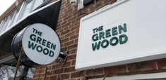 """Custom circular sign box and cut letters for """"The Green Wood"""" blends rustic Mediterranean flavours with down-to-earth home cooking. Earth Homes, Toronto, Letters, Rustic, 3d, Signs, Cooking, Green, Country Primitive"""
