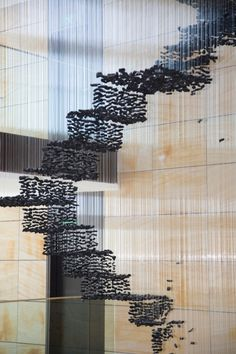 Suspended Charcoal Installations Echo Man-Made Figures - My Modern Metropolis