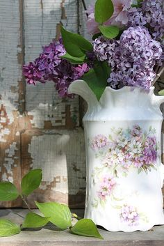 lilacs in a pretty pitcher....close your eyes,...... now just imagine the sweet fragrance wafting lightly from this place.