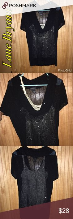 🆕Lane Bryant Sheer Knit Top Sz 14/16 Beautiful open-knit black cowl neck top. It is stretchy and best fit for sizes 14-16. A sequin tank top is shown underneath to show that it is sheer (Sequin tank not included). Machine washable. EUC. Lane Bryant Tops